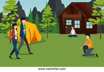 women and men with cabin and camp around the trees