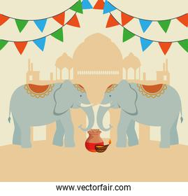candle with elephants and party banner with taj mahal