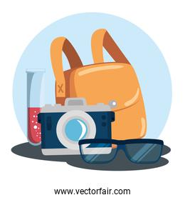 photographer camera with lipstick and bag with glasses