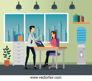 businesswoman and businessman with lap in the desk and chair