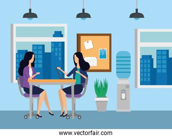 businesswomen sitting in the chairs with desk and noteboard