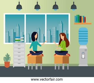 businesswomen sitting in the chairs with file cabinet and books