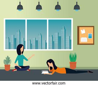 businesswomen reading book with plants and noteboard