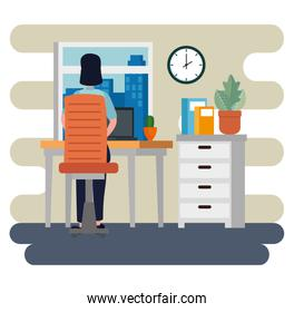 businesswoman sitting in the chair with laptop and file cabinet