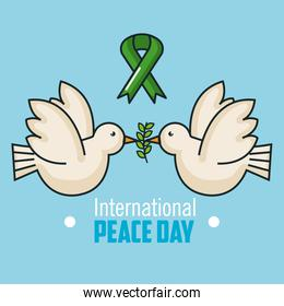 international peace day two dove flying and branch olive