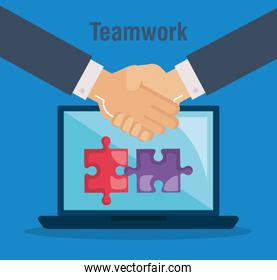 laptop with puzzle game teamwork icons