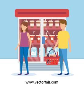 couple in supermarket refrigerator with products