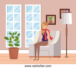 woman with winter clothes in livingroom