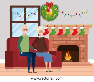 grandparents in livingroom with winter clothes