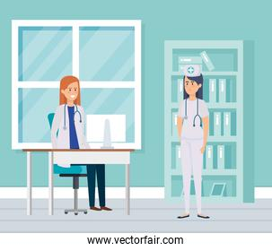 female doctor and nurse in consulting room