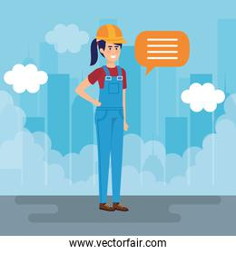 smiling female builder constructor talking in the city