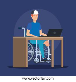 disabled man sitting wheelchair and working with laptop