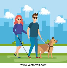 woman and man blind wearing sunglasses and dog