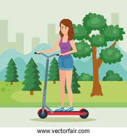 woman riding electric scooter in the park