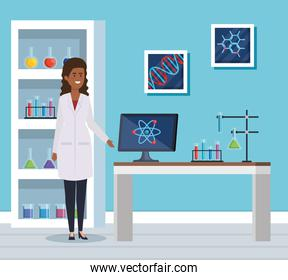 woman chemist with computer and erlenmeyer flask