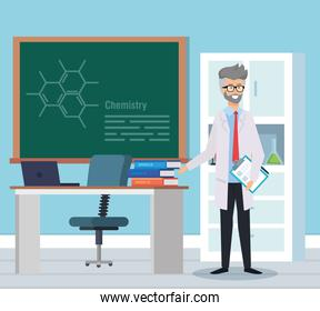 old man chemist with books and blackboard