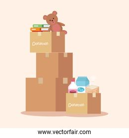 boxes donation with books and teddy with food