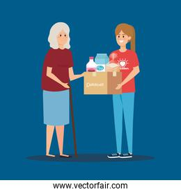 girl volunteer with box donation to old woman