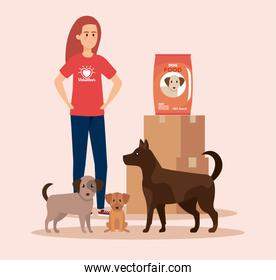 girl volunteer with dogs and boxes with food