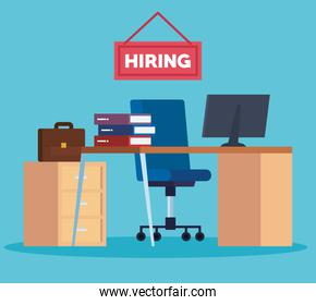 office hiring with computer in the desk and books
