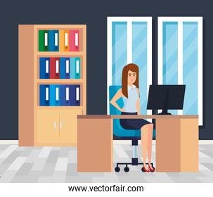 executive businesswoman with computer in the desk and bookcase