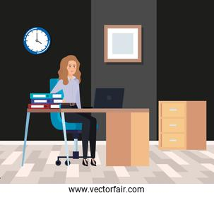 professional businesswoman with laptop in the desk and books
