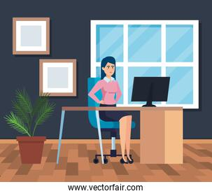 professional businesswoman with computer in the desk with diplomas
