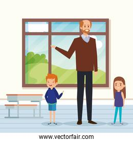 man teacher in the classroom with kids and desk