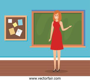 woman teacher in the classroom with blackboard and note board