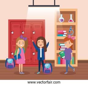 girls students with books and erlenmeyer flask in the bookcase
