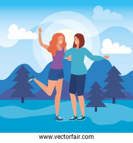 girls friends together with in the nature landscape