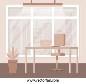 desk with laptop and chair with plant and window