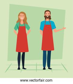 set of saleswoman and salesman with hairstyle wearing apron