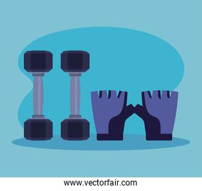 dumbbells with gloves over blue background