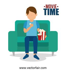 man watch movie  seated in sofa