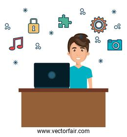 character man on desk and laptop with icon media graphic