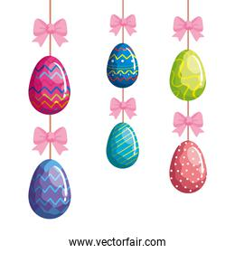 cute eggs easter decorated hanging with pink bows ribbons