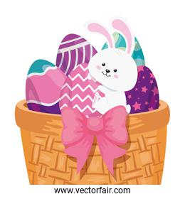 rabbit and cute eggs easter decorated in basket wicker