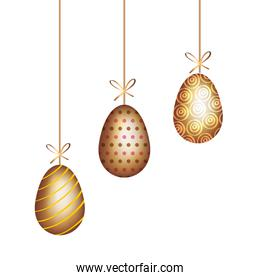isolated golden eggs easter decorated hanging