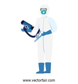 person with biohazard suit protection and microscope