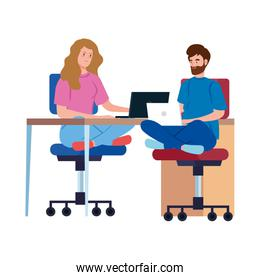 couple working telecommuting with laptop in desk