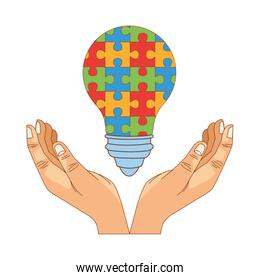 hands lifting bulb with puzzle game pieces