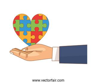 hand lifting heart with puzzle game pieces