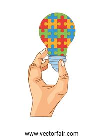 hand lifting bulb with puzzle game pieces