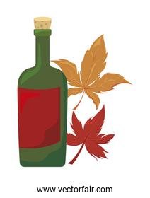 bottle of wine with autumn leaves on white background