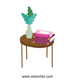 stacked books and plant in vase on table, book day