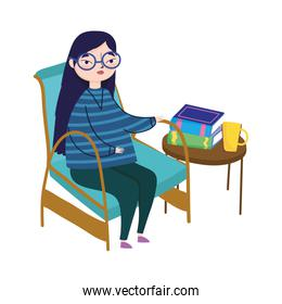 young woman sitting in chair and table with books coffee cup, book day
