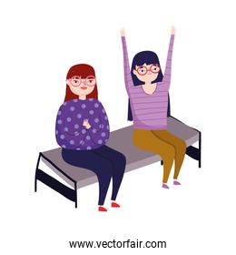 two young women with glasses sitting in chair isolated icon