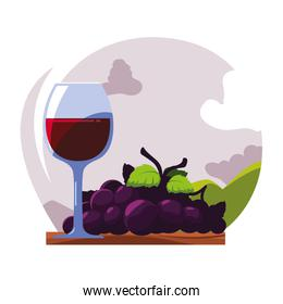 wine glass with grapes on background landscape