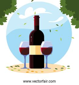 bottle and glass of wine with background landscape